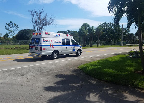 One of many medical vans heads to the Rehabilitation Center at Hollywood Hills in south Florida to evacuate patients last week after a power outage.