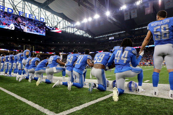 Members of the Detroit Lions take a knee during the anthem before a against the Atlanta Falcons at Ford Field on Sunday in Detroit.