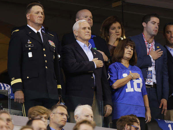 Vice President Pence and his wife, Karen, stand for the national anthem before Sunday's game between the Indianapolis Colts and the San Francisco 49ers in Indianapolis.