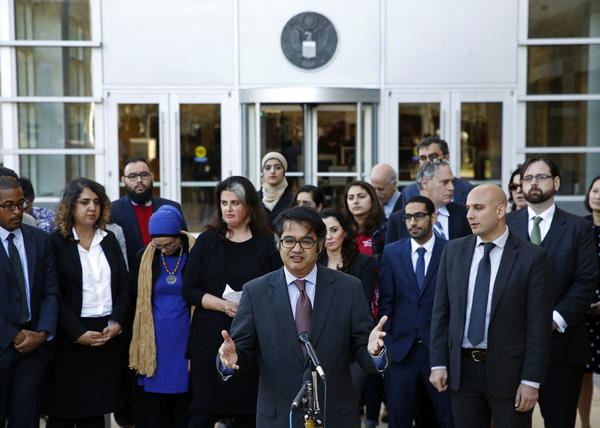 Omar Jadwat (center), director of the ACLU's Immigrants' Rights Project, speaks outside a federal courthouse in Greenbelt, Md.
