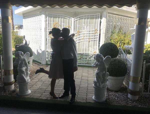 Agnes Kolodziaj and Lucas Pawelek kiss in front of the Gazebo at A Little White Wedding Chapel. The Polish couple started planning their Las Vegas nuptials six months ago.