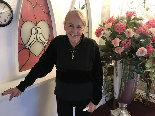 """Charolette Richards, 83, is the owner of A Little White Wedding Chapel. She's been marrying people for some 60 years. Las Vegas has never been Sin City to her, she says. It's """"love, love, love."""""""