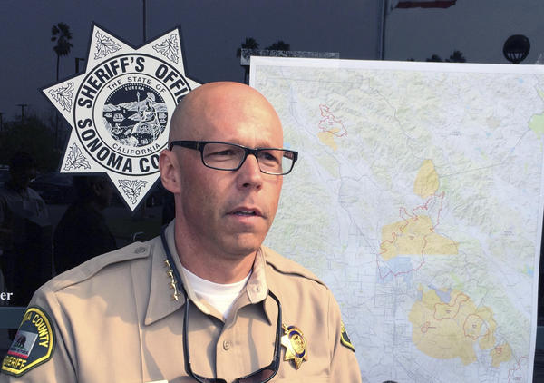 Sonoma County Sheriff Rob Giordano updates the media on evacuation and search-and-rescue efforts on Oct. 11, as wildfires devastate the county. At a more recent news conference, Giordano struck down wildfire-related rumors circulating on social media.