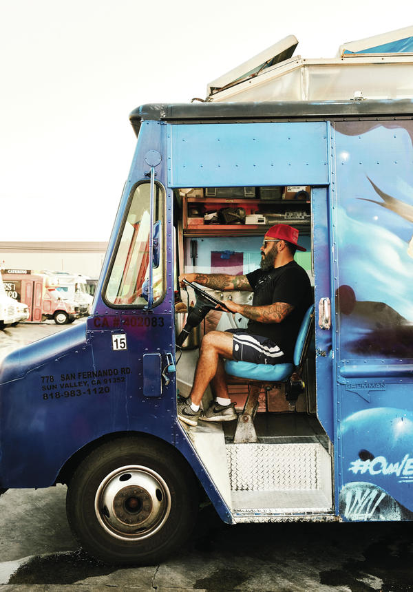 Wes Avila behind the wheel of the Guerrilla Taco food truck, a 1983 Chevy painted Dodgers blue.On the menu you'll find tacos with wild boar and thick-cut bacon, wild porcini mushroom and corn quesadillas, and Thai snapper tostadas.