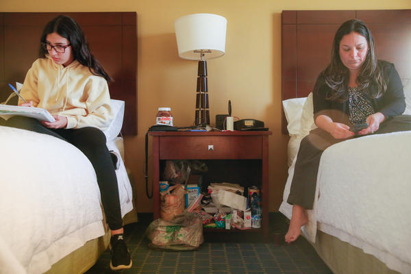 Darianne and her mom, Yesenia González, in their hotel room by the Orlando airport. Sharing one room has been hard, says Eliud Peña, the girls' stepdad.