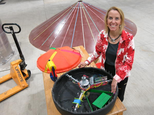 Belinda Batten of Oregon State University stands in front of a wave energy generator prototype.