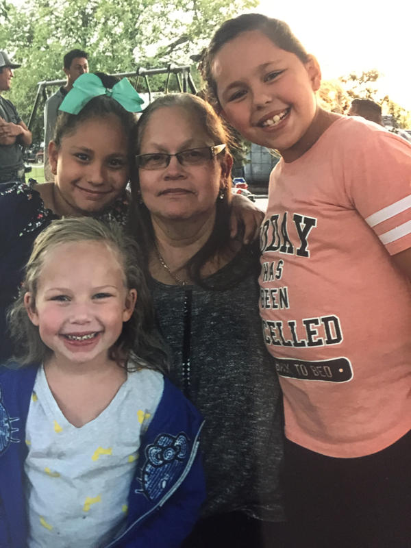 Brooke Ward, left front, Emily Garcia, left back, and Rhianna Garcia, right, with their grandmother Dalia Lookingbill.