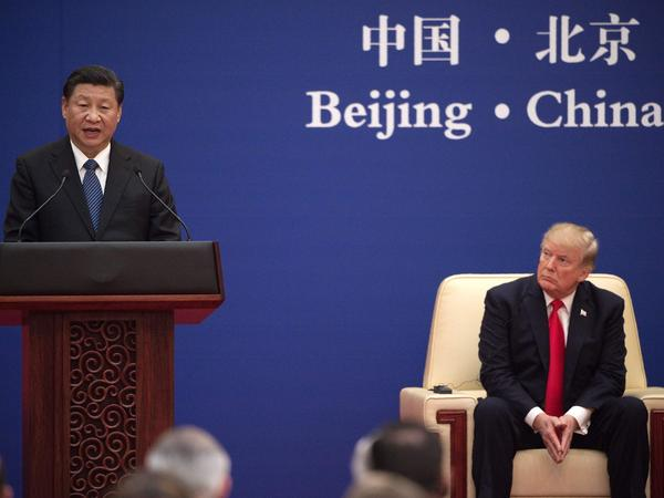 China's President Xi Jinping speaks during a business leaders' event with President Trump in Beijing on Thursday.