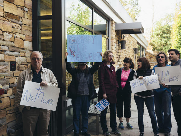 Protesters gather outside as Roy Moore, Republican candidate for U.S. Senate, appears at a mid-Alabama Republican Club's Veterans Day event in Vestavia Hills, Ala., on Saturday.