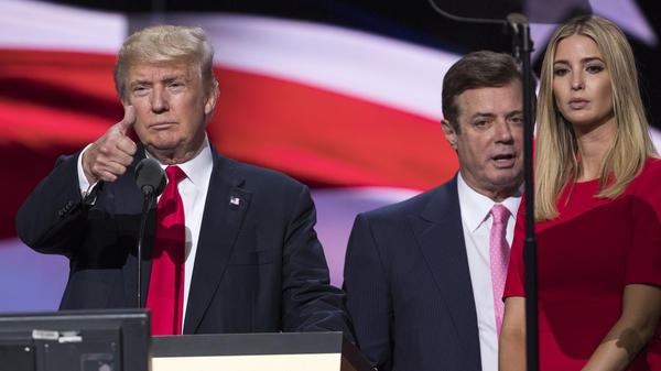 President Trump gives a thumbs up at the Republican National Convention, as then-Trump campaign Chairman Paul Manafort stands behind him and next to Ivanka Trump.