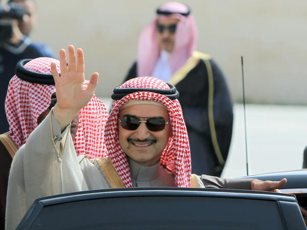 Saudi Prince Alwaleed bin Talal waves during an official visit to the West Bank city of Ramallah in 2014. The Saudi billionaire was detained last month in Riyadh and has not been seen since.