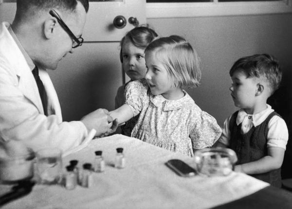 Children get their diphtheria inoculation in 1944.
