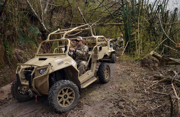 Santini and his team brought Humvees to Puerto Rico — but they were difficult to navigate in the island's terrain. Instead, they prefer all-terrain vehicles or the Jeeps they rented in San Juan.