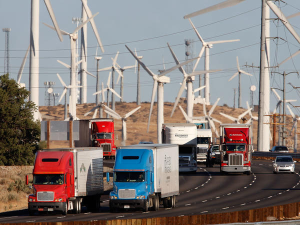 Seeking to cut greenhouse gas emissions in California by 40 percent by 2030, state regulators have approved a plan that offers incentives for truck and bus fleets to go green.