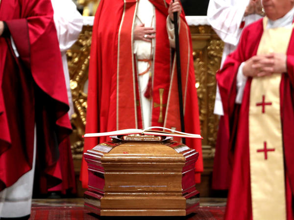The coffin of Law, who died this week, sits at the St. Peter's Basilica on Thursday. His death  reawakened a flood of emotion and anger over the decades of sexual abuse that finally came to light in 2002.