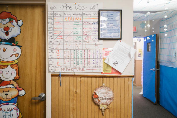 A calendar detailing the weekly schedule for adults with intellectual disabilities hangs in a room at the Arc Northeastern Pennsylvania.