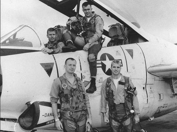 John McCain (front, right), with his squadron in 1965, McCain, was captured by the Vietnamese, tortured and imprisoned for more than five years.