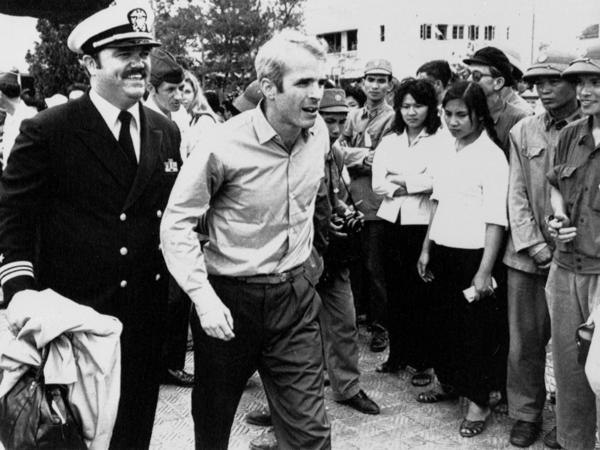 John McCain is escorted by Lt. Cmdr. Jay Coupe Jr. to Hanoi's Gia Lam Airport on March 14, 1973, after 5 1/2 years as a prisoner of war.