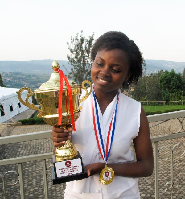 Mireille with one of her debate trophies, on the campus of the Akilah Institute for Women.