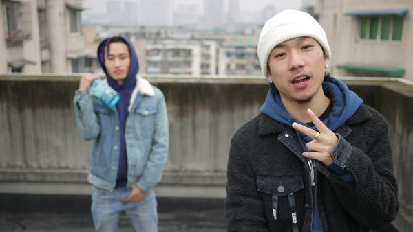 Rappers Young13DBaby (left) and TSP beside their rooftop studio in downtown Chengdu. The two rappers are both Tibetan and sometimes write songs about growing up as ethnic minorities in Han-majority China.