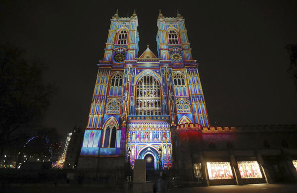Westminster Abbey in London is illuminated by a projection entitled <em>The Light of the Spirit</em> by Patrice Warrener during the Lumiere London festival on Wednesday.