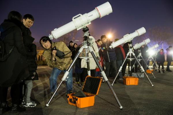 Skywatchers in China gather at Beijing Planetarium to watch a super blue blood moon eclipse with telescopes.