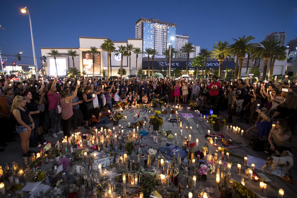 An October vigil is held one week after the mass shooting in Las Vegas. Newly unsealed documents reveal details of the early stage of the investigation.