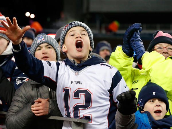 Young fans cheer after the New England Patriots defeat the Tennessee Titans at Gillette Stadium on Jan. 13, 2018, in Foxborough, Mass..