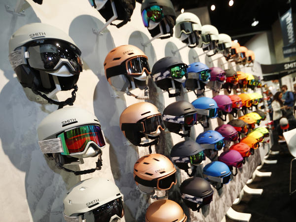 Ski helmets line a wall in the Smith booth at the Outdoor Retailer and Snow Show in Denver.
