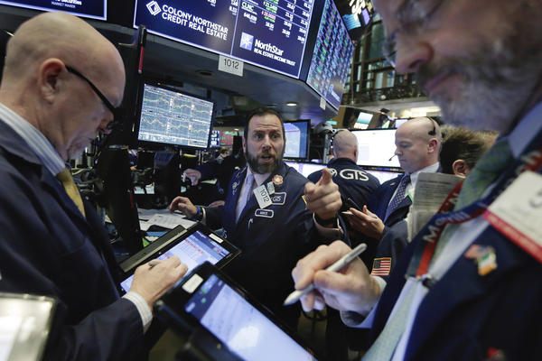 The stock market swung dramatically Wednesday, ending about where it started the day — after record losses earlier in the week.