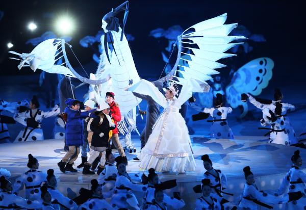 """Dancers perform """"The Land of Peace."""" The themes of the ceremony are harmony and convergence, and passion and peace."""