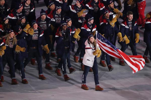 Flag bearer Erin Hamlin of the United States leads the team in the Parade of Athletes.