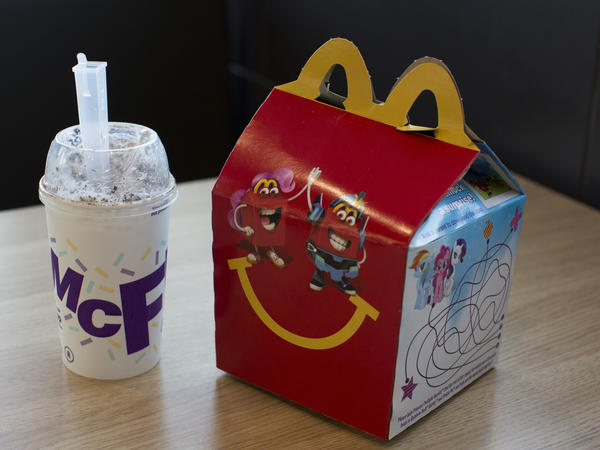 A Happy Meal and McFlurry are arranged for a photograph at a McDonald's Corp. fast food restaurant in Phoenix, Ariz. The company says in the next four years, 50 percent or more of its kids meals will meet new nutrition criteria, with 600 or fewer calories per meal and caps on calories from sugar and saturated fat.