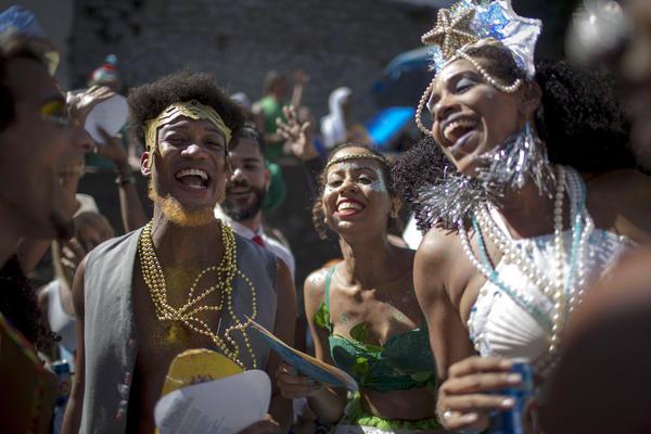 Revelers celebrate during the Carnival street parade of the <em>Bloco das Carmelitas</em> in the Santa Teresa neighborhood in Rio de Janeiro, Brazil, last week.