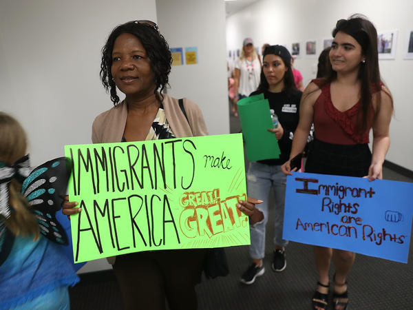 Anne Pierre joins with other activists in front of the office of Sen. Bill Nelson, D-Fla., to show support for recipients of the Deferred Action for Childhood Arrivals (DACA) program on Feb. 2 in West Palm Beach, Fla.