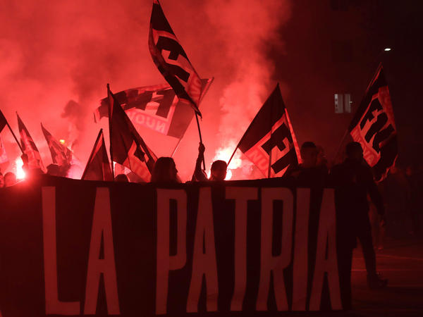 """Italian far-right party activists hold a banner reading """"fatherland"""" during a demonstration against a government proposal to reform citizenship procedures for the descendants of immigrants living in Italy, in Rome, Nov. 4, 2017."""