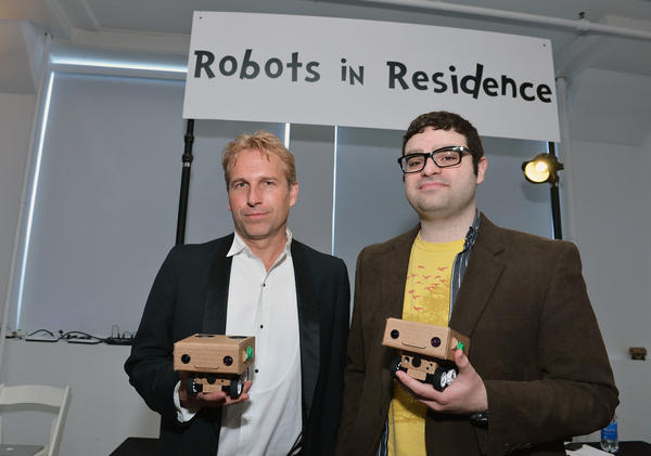 "Brent Hoff (left) and Alexander Reben, creators of ""Robots in Residence,"" hold BlabDroids at the 2013 Tribeca Film Festival in New York City. Hoff and Reben teamed up to see whether they could design a robot that would make people want to open up."