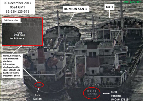 In this photo released by the U.S. Treasury Department, the North Korean vessel KUM UN SAN 3 (left) conducts a ship-to-ship transfer with the Panama-flagged KOTI on Dec. 9. The Treasury Department, which announced new sanctions on Friday, says this transfer shows North Korea's efforts to evade sanctions.