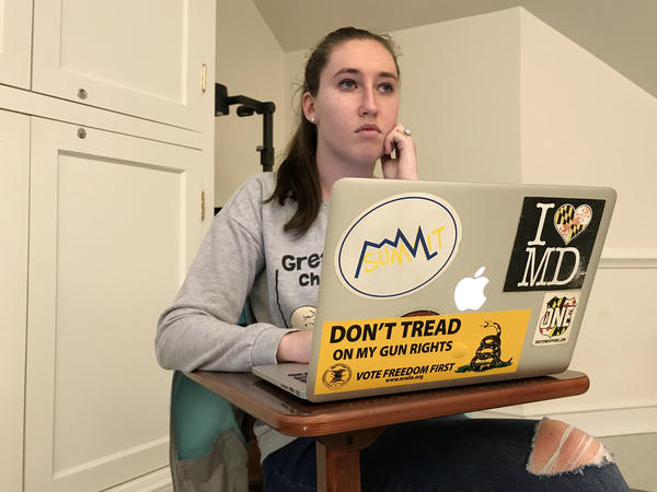 Jordan Riger, 22, uses her laptop to track attendance for a weekly meeting of Students for the Second Amendment at the University of Delaware in Newark, Del. She sees firearms as tools for self-defense.