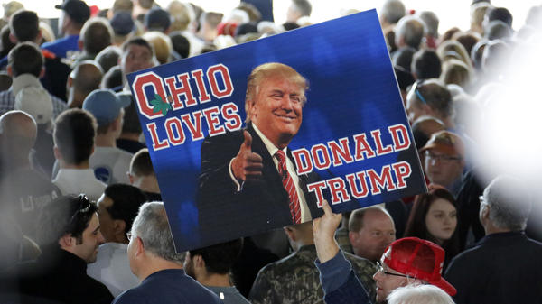 A supporter of Donald Trump holds a sign during a March 2016 rally in Vienna, Ohio. In the Mahoning Valley of Eastern Ohio, many traditionally Democratic voters switched sides to vote for Trump.