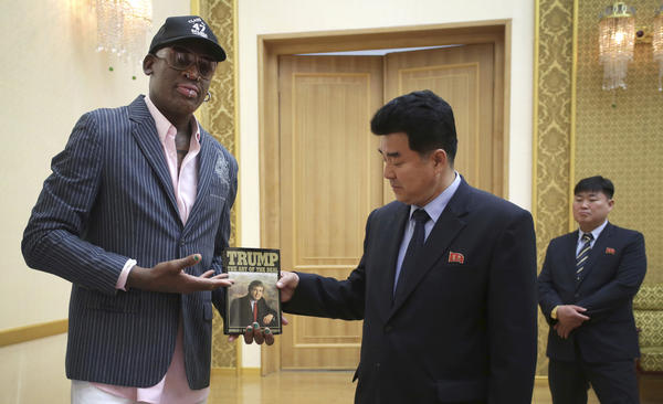 Former NBA star Dennis Rodman presents the book <em>The Art of the Deal</em> to North Korea's Sports Minister Kim Il Guk last June in Pyongyang, North Korea. Until this week, Rodman was believed to be the only person who had met both Kim and the U.S. president.