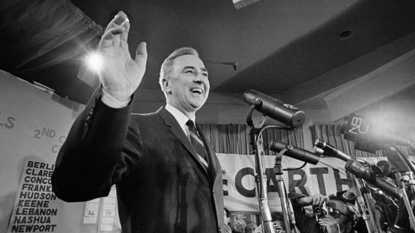 Sen. Eugene McCarthy, D-Minn., waves to supporters in his campaign headquarters, March 13, 1968, the day after the New Hampshire primary showed strong support for his opposition to the Vietnam war.