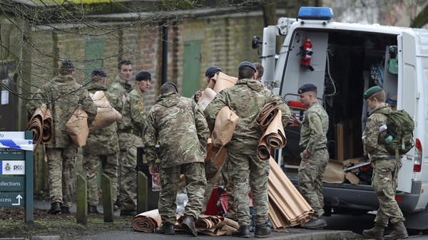 Military personnel outside Bourne Hill police station in Salisbury, England, Sunday, as police and members of the armed forces probe last week's suspected nerve agent attack on Russian double agent spy Sergei Skripal.