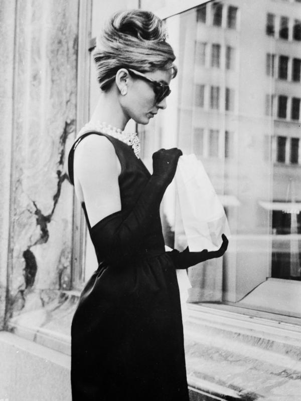 Audrey Hepburn wears a black dress by Givenchy in the opening scene of 1961's <em>Breakfast At Tiffany's</em>.