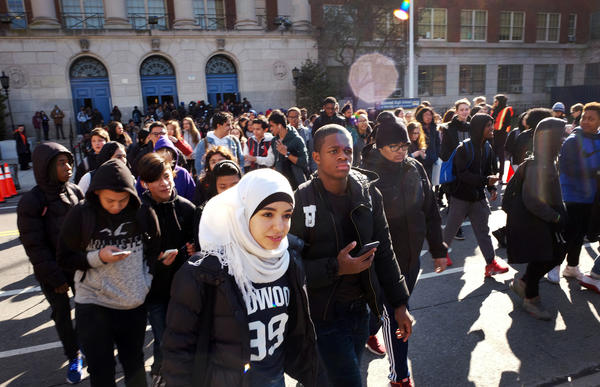 Hundreds of students walk out of Midwood High School on Wednesday, as part of a nationwide protest against gun violence in Brooklyn.