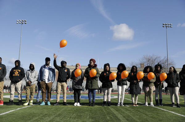 Eastern Senior High prepare to release balloons for the victims of the Florida school shooting and for victims of shootings in D.C.