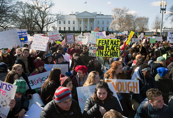 During a nationwide student walkout, thousands of local students sit in front of the White House in Washington, D.C., for 17 minutes in honor of the 17 students killed last month in a high school shooting in Florida.