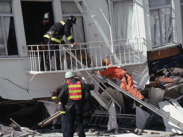 First responders in the Marina District disaster zone after an earthquake on October 17, 1989 in San Francisco, Calif.