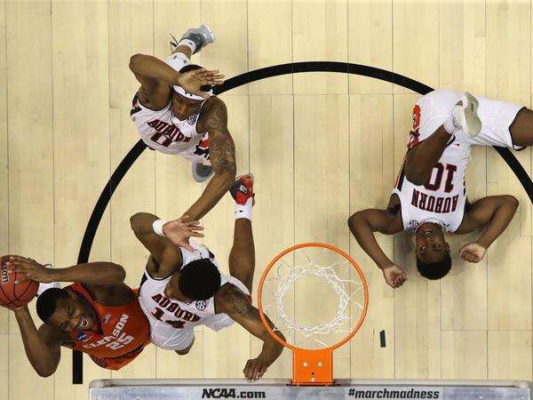 Clemson's Aamir Simms (25)  shoots against Auburn's Malik Dunbar (14) during a second round game of the 2018 NCAA men's basketball tournament last week. The NCAA will make $771 million from this year's tournament.
