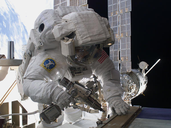 "Sunita Williams performs maintenance during a spacewalk outside the International Space Station in 2012. The astronaut has spent more than 50 hours ""spacewalking."""